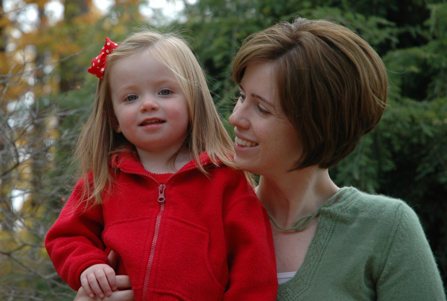 Toddler in red jacket with mom
