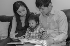 Mom and Dad reading to toddler in Albany, NY