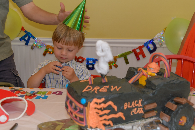 Photograph of birthday boy examining bow tie