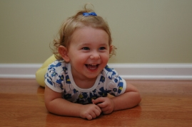 Smiling toddler with curls