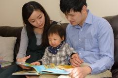 Family looking at dinosaur book