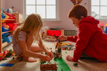 Brother and sister playing legos