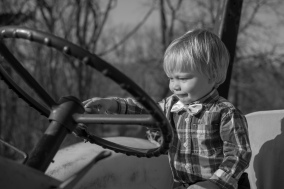 Boy driving tractor smiling