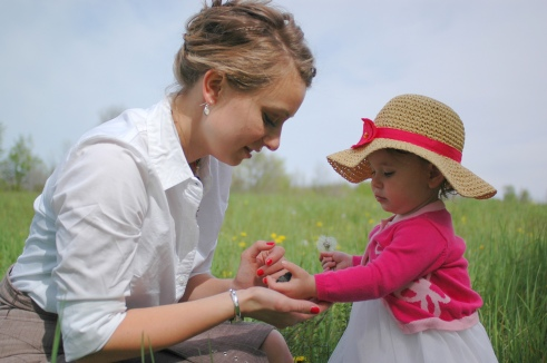 Mom and daughter looking at rocks and flowers