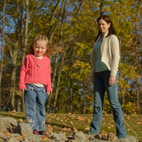 Mom and daughter on rocks