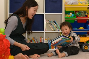 Mom and toddler holding books