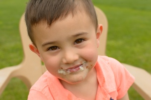 Boy smiling with ice cream around mouth