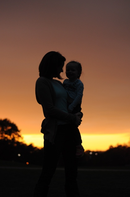 Mom and daughter with sunset