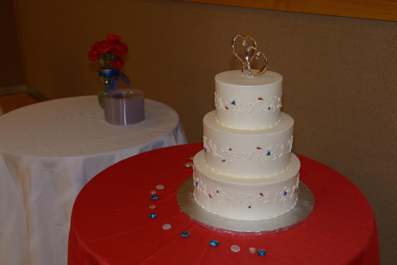 documentary style image of white wedding cake