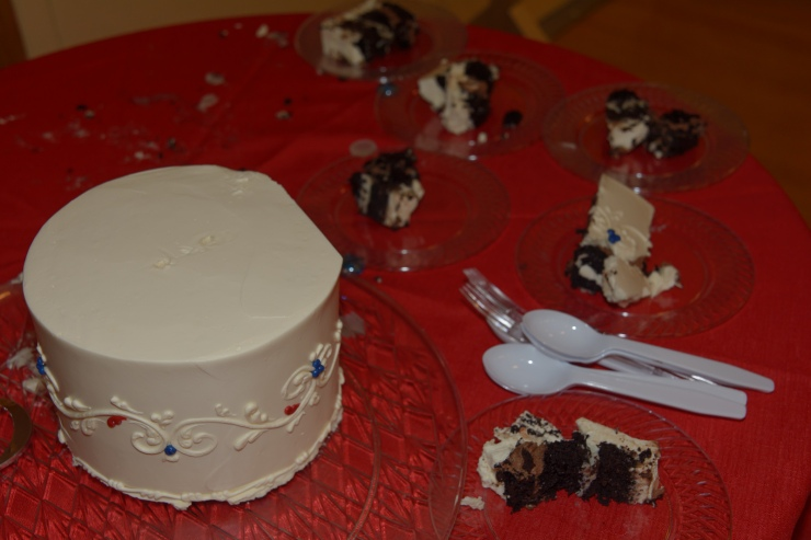 Top layer of wedding cake with pieces of cut cake
