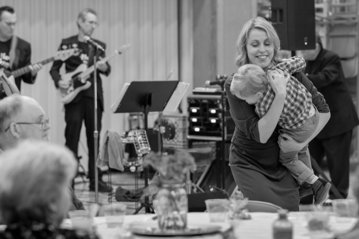 Documentary photo of mother dancing with son at wedding reception