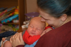 Mom holding newborn