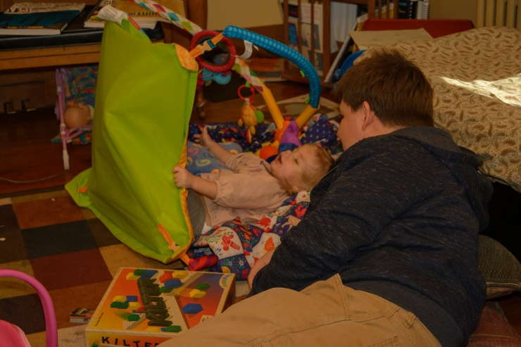 Toddler and Dad playing in a blanket fort