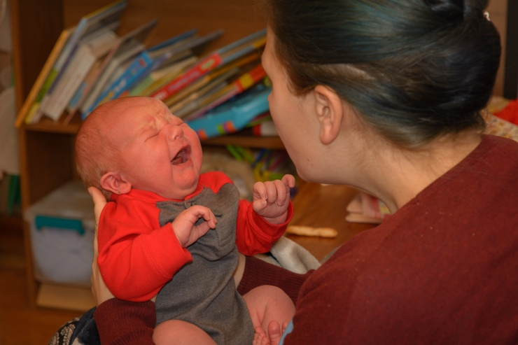 Documentary newborn picture of crying baby