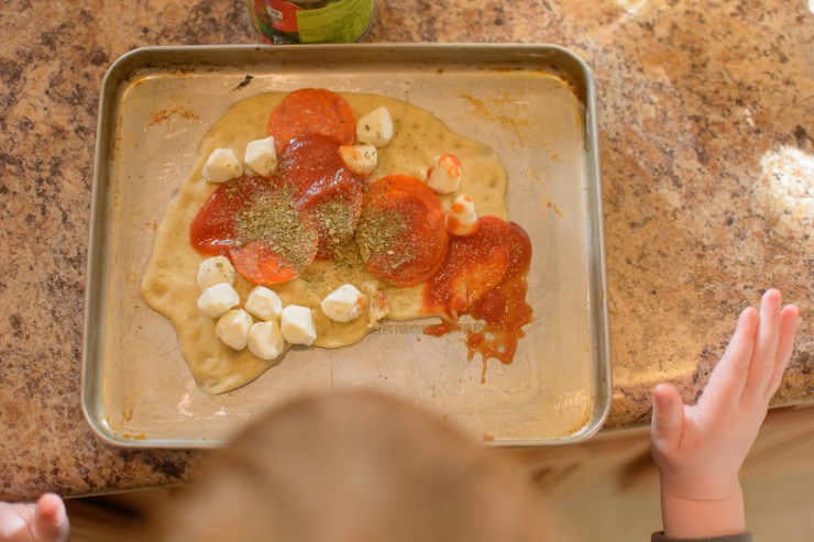 Bird's eye view of toddler's pizza