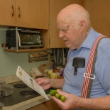 Man holding recipe and cucumbers