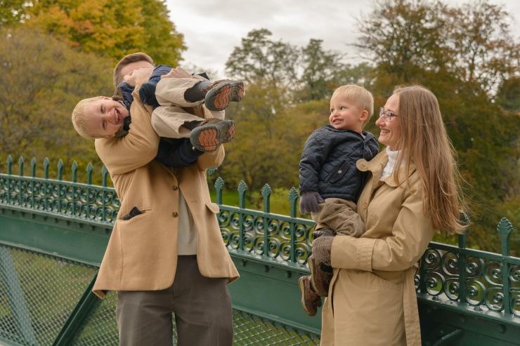 Dad tickling boy on bridge