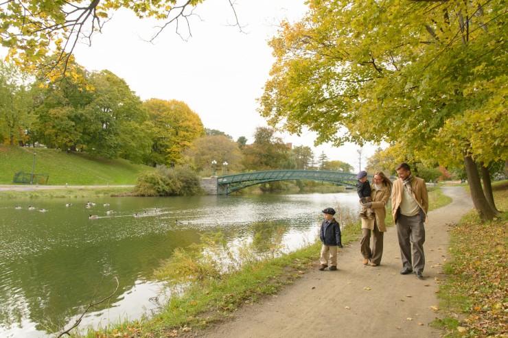 Family walking next to lake