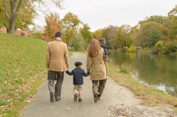 Back of family walking