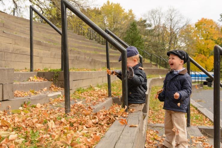 Boy laughing through leaves