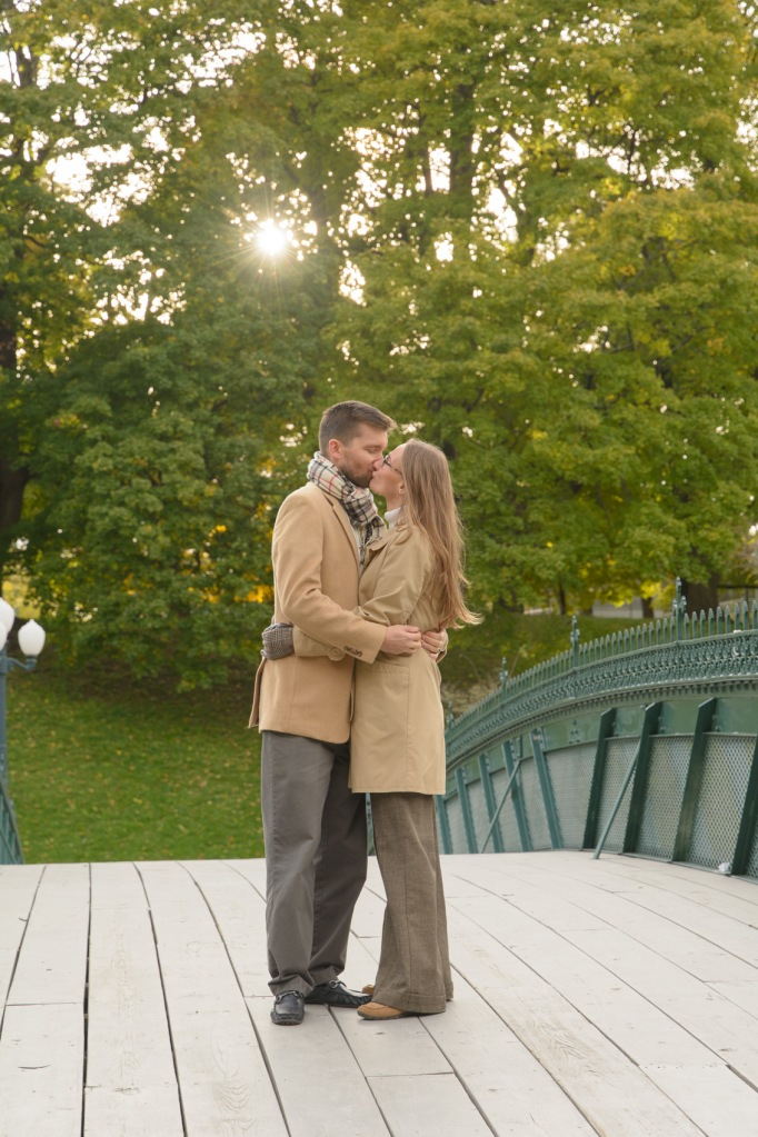 Mom and Dad kissing on bridge