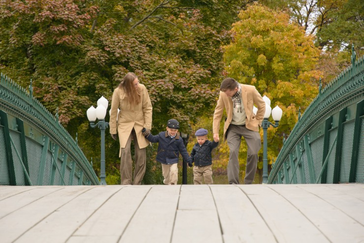 Family running on bridge
