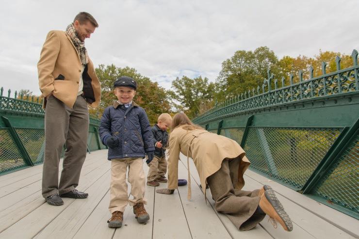 Family playing on bridge