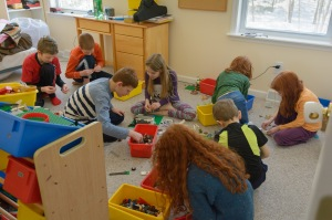 Girls and boys playing legos