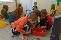 Room of legos and kids playing