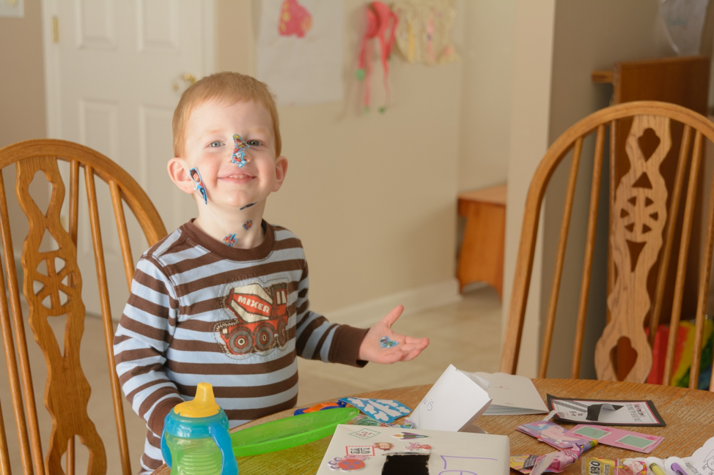 Preschooler with stickers on his face