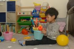 Preschooler with bucket of tools