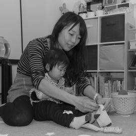 Mom helped toddler put on socks