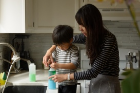 Boy and mom making colored water
