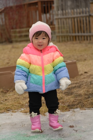 Infant with rainbow colored coat