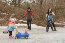 Family playing outside in snow