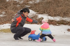 Dad and infant with push toy