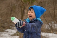 Laughing boy with spray bottle