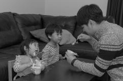Dad feeding kids yogurt