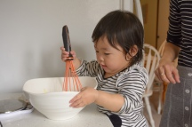 Little girl stirring a bowl