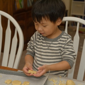 Boy with snowflake shaped cookie