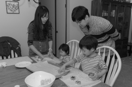 Family making cookies together