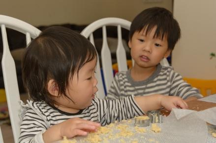 Kids making cookies at table