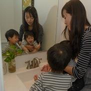Mom helping kids wash hands