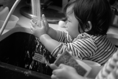 Infant reaching for kitchen sink water