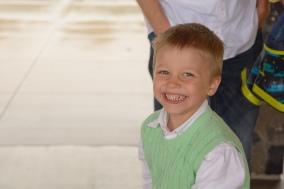 Young boy laughing at camera