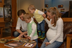 Family looking at book together
