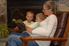 Pregnant mom reading with two boys