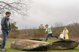 Boy jumping between rocks