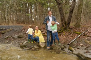 Family near a stream