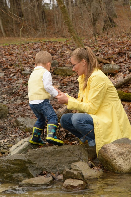 Mom in yellow jacket with boy in yellow vest